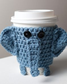 Crocheted Cuddly Elephant Coffee Cup Cozy by CuddlefishCrafts from CuddlefishCrafts on Etsy. Saved to Sole Gems. Crochet Coffee Cozy, Coffee Cup Cozy, Crochet Cozy, Crochet Gifts, Cute Crochet, Coffee Cups, Hot Coffee, Coffee Beans, Yarn Projects