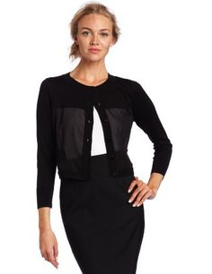 Cluny Women's Spliced Cardigan Cluny. $94.00. Elbow length sleeves with ribbed finishing. 53% Silk/47% Cotton. Front pockets. Dry Clean Only