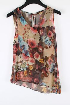 Let's do something Stunning when it comes to Florals. Gorgeous Rose Print Layered Chiffon Top with Peek a Boo Back Button Detail. Grab a Bla...