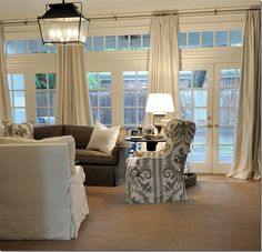 Nice window treatment for multiple double French doors or sliding glass doors, but for at a door the length should be exactly floor-length and not puddled or even a soft break. Found in a blog written By Kara Martin, Window Curtains: Your Custom Curtain Checklist, November 4, 2013 at: UpholsteryVancouver.Ca