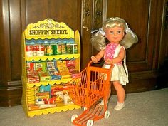 Wish I still had my Shoppin Sheryl doll. She has a magnet in one hand and the other opens and closes so she can actually pick up her groceries and put them in her shopping cart. She definitely needed more groovy clothes, but otherwise, perfect!