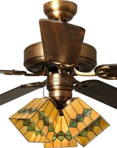Tiffany Street 269540007 Martini Mission 3-Light Stained Glass Antique Brass Ceiling Fan 52 inch three-light, 5 blade indoor Tiffany-style stained glass fan.. Includes: Five American Walnut blades - (52 Span / 11° Blade Pitch). 2 Ways to Install (Flush or With 4 Downrod).. Three fan speeds (high/medium/low) and reversible switch for customized comfort.. Manufacturer limited lifetime warranty. S... #TiffanyStreet #Lighting