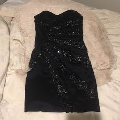 Jessica McClintock Black Sequin Dress Selling a strapless black dress from Jessica McClintock with pretty sequin detail. Amazing quality- only worn once (to prom).  If you have any questions or would like to see any additional photos, please feel free to ask! Thank you and happy shopping  Jessica McClintock Dresses Strapless