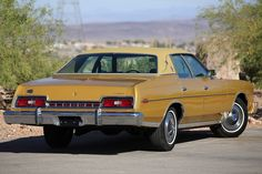 On 06/17/74, Mrs. Olson put $100 down on a new Ford LTD Brougham in Gold Glow she selected at Rick Warner Ford in Salt Lake City, UT. On 7-19-74 Mrs. Olson signed a sales contract for $5,497.56. She scored a rear defogger, gold landau bars, heavy duty shocks, floor mats and locking gas cap in the deal. The following Monday, Mrs. Olson arrived at the dealership with a check from her Credit Union in the amount of $5,398.56. 40 years later, the car retains just 8,378 miles on the odometer.
