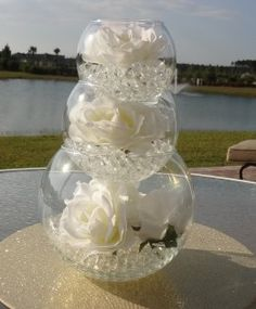Beautiful wedding centerpiece using water beads. ( I saw these in another pin, and I really like the idea of the fishbowls being stacked, but I would have used different colors than clear and white, not enough color for me)