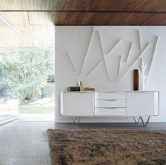 CEMIA. A Collection of double-sided, stand-alone pieces characterised by a structure with 4 rounded corners: this is composed of 2 sheets of moulded, arched multi-ply, linked along their edges by a cross joint highlighted by a lacquered metal strip.The curved lacquered zamac handles are set into the fronts of the doors. Satin white lacquer/Gloss white lacquer Walnut/Gloss white lacquer Walnut/Black lacquer Sideboard H72 W196 D50 CM