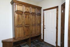 Mud Room idea - I like a closed closet design for coats.