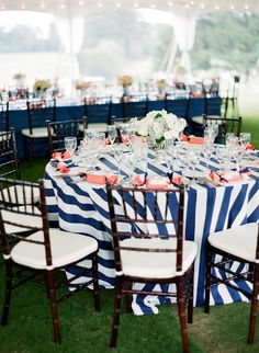Instead of dramatic centerpieces we could use fun linens for the cirque theme (not necessarily stripes)