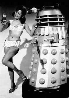 Bikini girls with a Dalek robot, 1950s