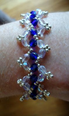 Beaded bracelet in zig zag pattern with royal blue rondells, clear crystals and silver Miyuki seed beads. $20.00