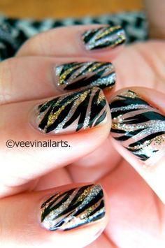 Black, silver * gold  glitter and nude tiger stripe mani