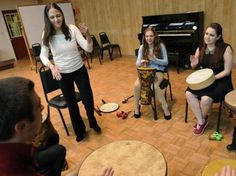 Lisa Summer (standing) with students at Anna Maria College, where she directs the music therapy program