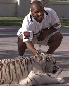 Mike Tyson with his white bengal tiger.