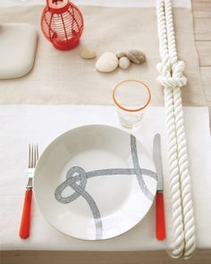 Rope Tablecloth Anchor  This knotted rope adds a nautical touch to your table -- and keeps an outdoor tablecloth from blowing away. #marthastewart