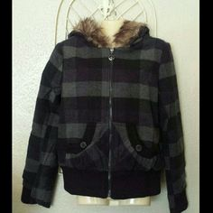"""✴DOLLHOUSE ZIP UP JACKET WITH HOOD✴ ✴ jacket is constructed of brushed wool-blend fabrication ✴Grey, navy, and black gaingham pattern throughout ✴Faux fur hood ✴Zipper closure in front ✴Rib-knit trim kangaroo pockets at the waist ✴Cuffs and hem are finished with double rib knit ✴Measures approximately 23"""" long from shoulder to hem ✴Waist 19 1/2""""  ✴arm is approximately 26"""" ✴Shell is 10% wool, 90% polyester, lining 100% polyester, rib knit. 100% acrylic, Fox 4 80% acrylic, 20% polyester…"""