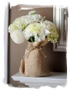 burlap wrapped glass vases - barn wedding idea