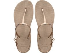 <p>The Freedom Sandal features an adjustable metallic slingback strap for a stylish look and secure fit. The injected, molded sole provides added comfort with our signature textured footbed.</p><ul><li>Thong style with slingback strap</li><li>Cushioned footbed with textured rice pattern and rubber flip flop sole</li><li>Made in Brazil</li></ul>