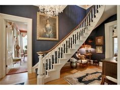 antebellum entryway...love the staircase and chandelier