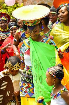 A Zulu wedding, like many other African weddings is full of vibrant colours, and the beaded jewelry plays a big role on the big day. The bride and her groom will wear matching colours to show people that they are an item. The girl is claiming her man.