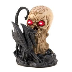 "Beware the skull and dragon and their deadly devilish glow! This frightening figurine casts an eerie light over your surroundings, creating a chillingly mystical scene. A true fright, day or night!  Weight: 1.0 lb. 4 3/4"" x 5"" x 6 1/2"" high. Polyresin. Two AA batteries not included."