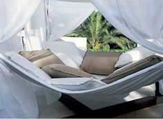 The giant hammock that comes with a canopy. | 30 Impossibly Cozy Places You Could Die Happy In