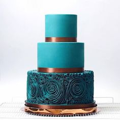 This teal cake with copper accents to die for. Created by @tortikannuchka