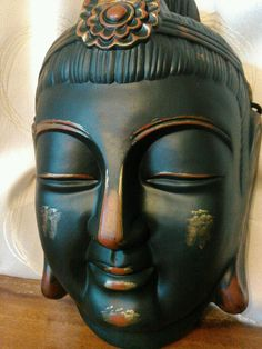 Check out this item in my Etsy shop https://www.etsy.com/listing/228822085/japanese-clay-buddha-mask-hand-made