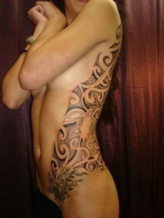 Side, ribcage, back, shoulder and hip tattoo. Love the turtle and the way if follows her body. Kinda hot.
