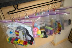 Busy bags for rest time, put in ziplock baggies hang on a towel rack instead of plastic containers