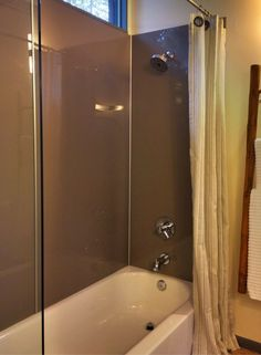 These mocha colored high gloss tub panels provide a grout free alternative to tile. Get 5 secrets facts about these panels in this article. @InnovateBuild