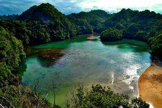 Pergilah ke Pulau Sempu, Malang.  Pulau Sempu adalah sebuah cagar alam yang menjanjikan udara segar dengan sensasi layaknya memiliki private island.