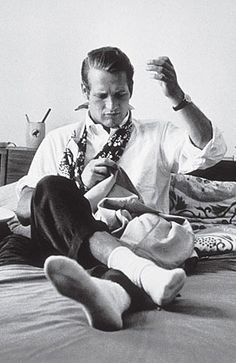Paul Newman, sewing.