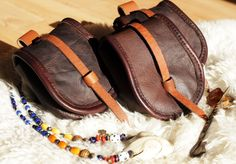 Viking belt pouches. Reconstructed from findings at Birka, Sweden. From Deviantart by ~hollow-reenact.