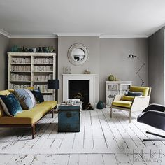 Shades of grey set the contemporary tone in this Bristol home, accented by tones of yellow and petrol blue that stand out against the distre...