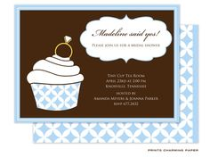 Yummy Blue Cupcake Ring Invitation: This charming invitation features a rich chocolate brown background with a large white and sky blue cupcake garnished with a wedding ring on top. The party invite pops inside a decorative shaped white panel, with additional details printed in white text below. The same blue and white pattern in the cupcake is also printed on the back of the card as a fabulous accent.