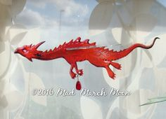 Solo móvil dragón dragón colgante de color intenso