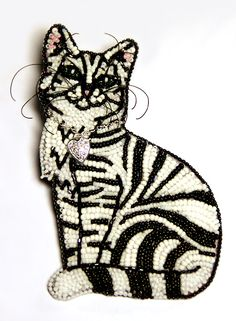 Amazing beadwork brooch by Lyubov Tyurina. Cats - my favorite subject these days and an exquisite piece of art to wear. I would love to purchase this but there is no indication that it is even on the market and I shiver to think of what it might cost. I am just simply blown away with the intricate work involved in the making of this pin. Tiny wee beads and the ability to create a cat of this caliber with them.   WOW!!