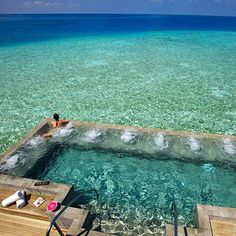 Maldives - I would never go swimming (fear of sharks) but would love to stand up there enjoying the view ^^ And trust me i can enjoy this view for 2 weeks ;)