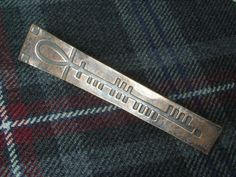 Check out this item in my Etsy shop https://www.etsy.com/uk/listing/209874305/scottish-kilt-pin-brooch-in-bronze-ogham