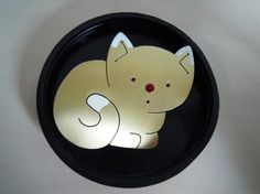 How cute is this one? Bronze, silver and enamel.