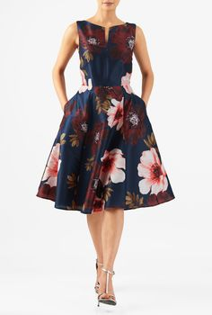 A split neck tops our floral print polydupioni dress designed with a fitted tank bodice and seamed waist atop a full flare skirt.