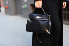 Black hermes kelly bag.