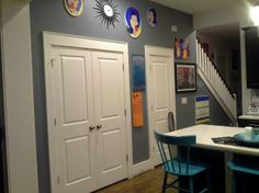 """Odd pantry wall in kitchen - Paint color: """"Sharkfin"""" by Valspar (Lowe's), and my own artwork"""