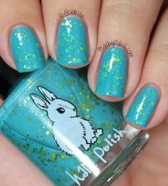 """From Hare Polish: """"Bisbee"""" has gold glitter and shimmer in a turquoise base."""