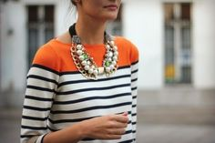 Funky sweater topped with a bold necklace