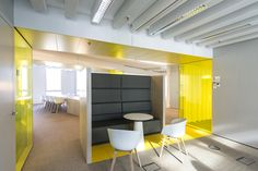 Beautiful breakout area with quiet booth. White and yellow office. Corporate Interior Design, Corporate Interiors, Commercial Interior Design, Commercial Interiors, Office Space Design, Workplace Design, Space Interiors, Office Interiors, Design Thinking
