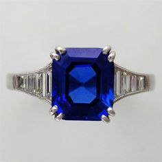 A KASHMIR SAPPHIRE AND BAGUETTE DIAMOND RING. $35,000! By Gubelin (Swiss)
