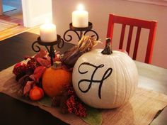 Thanksgiving decor. love the white pumpkin with the monogram.