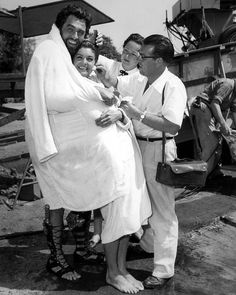 """Howard Keel and Esther Williams bundle after emerging from a swimming scene for """"Jupiter's Darling"""" Hairdresser Jane Gorton and makeup man Frank McCoy prepare the actress for the next shot. Golden Age Of Hollywood, Classic Hollywood, Old Hollywood, Male Makeup, Makeup Man, Million Dollar Mermaid, Howard Keel, Rhonda Fleming"""
