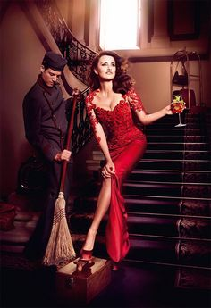 May: A man sweeps Penelope's foot. This is considered to mean you're a woman not fit for marriage © Campari            Compari Calender 2013  Dress: Marchesa